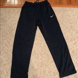 Navy Nike men's sweats with zippered side pockets